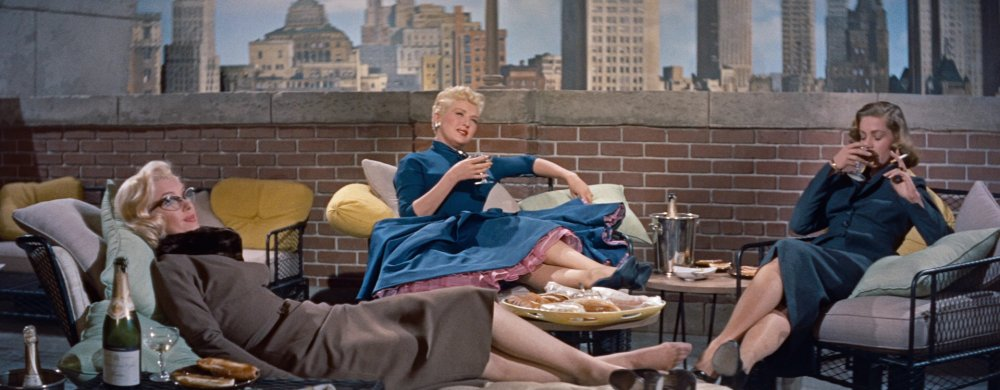 how-to-marry-a-millionaire-1953-002-marilyn-monroe-betty-grable-lauren-bacall-sitting-balcony.jpg.b9175beacf34ed0f8311505ddc35b2bf.jpg