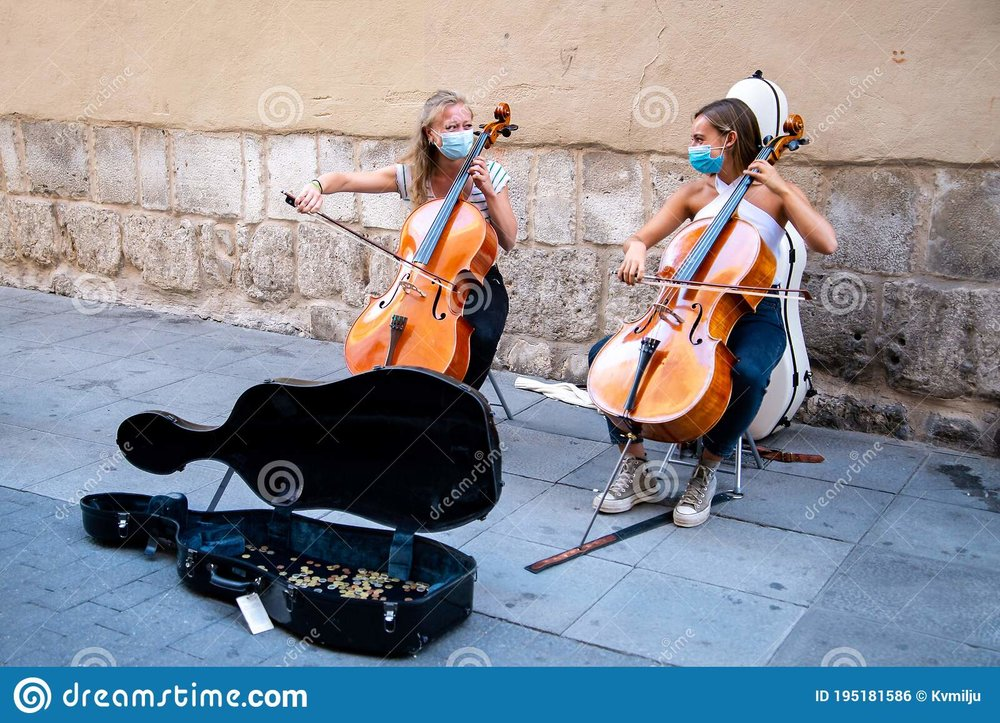 ladies-playing-violin-valladolid-spain-september-two-young-big-street-wear-face-mask-195181586.jpg